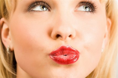 simsearch:400-04801287,k - Close-up of pretty blonde looking aside with her lips fixed in kiss Stock Photo - Budget Royalty-Free & Subscription, Code: 400-04101220
