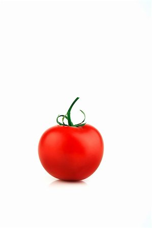 Image of a bright red single tomato on a white background Stock Photo - Budget Royalty-Free & Subscription, Code: 400-04103329