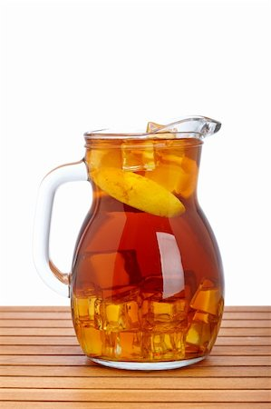 Ice tea pitcher with lemon and icecubes on wooden background Stock Photo - Budget Royalty-Free & Subscription, Code: 400-04114279