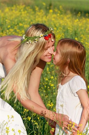 daughter kissing mother - loving mother and daughter on nature Stock Photo - Budget Royalty-Free & Subscription, Code: 400-04114356