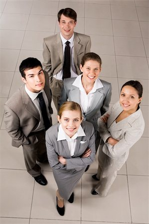pressmaster - Portrait of confident business group standing on the floor and looking at camera with smiles Stock Photo - Budget Royalty-Free & Subscription, Code: 400-04114380
