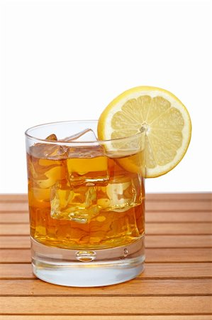 A glass of ice tea with lemon slice on wooden background. Shallow depth of field Stock Photo - Budget Royalty-Free & Subscription, Code: 400-04116100