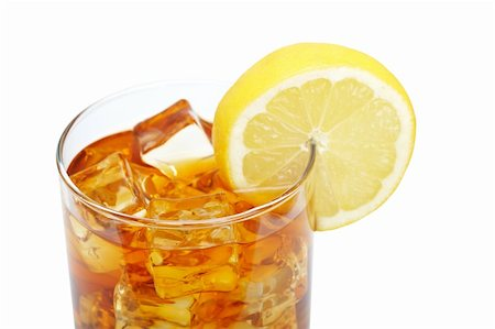 A glass of ice tea with lemon slice isolated on white background. Shallow depth of field Stock Photo - Budget Royalty-Free & Subscription, Code: 400-04116727