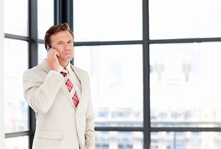 Mature businessman talking on phone with copy-space Stock Photo - Budget Royalty-Free & Subscription, Code: 400-04118250