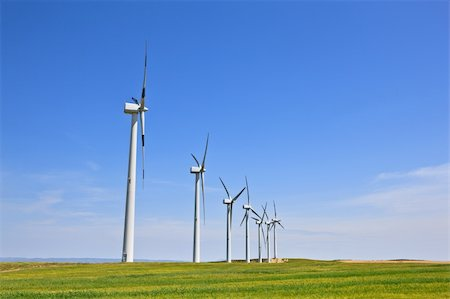Wind turbines farm in green field over cloudy sky Stock Photo - Budget Royalty-Free & Subscription, Code: 400-04119057