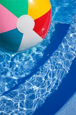 spanishalex (artist) - Multicolored Beachball in a beautiful blue swimming pool Stock Photo - Budget Royalty-Free & Subscription, Code: 400-04119071