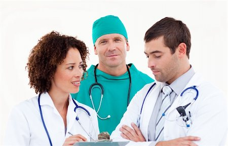 Surgeon in Discussion with Senior Doctors Stock Photo - Budget Royalty-Free & Subscription, Code: 400-04112062