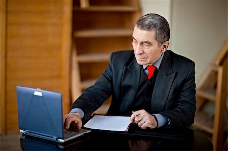 Business man typing and working on laptop computer Stock Photo - Budget Royalty-Free & Subscription, Code: 400-04113148