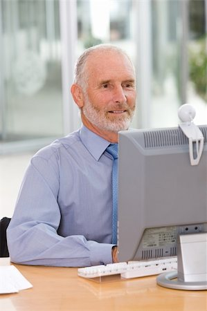 Business man working on laptop Stock Photo - Budget Royalty-Free & Subscription, Code: 400-04113368
