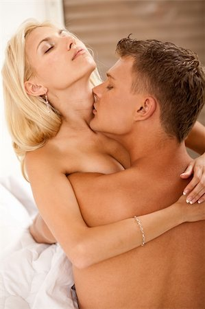 Passionate couple enjoying in bed Stock Photo - Budget Royalty-Free & Subscription, Code: 400-04126985