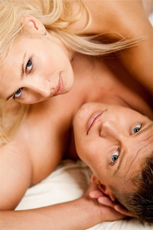 man and woman in bed looking at camera Stock Photo - Budget Royalty-Free & Subscription, Code: 400-04126982