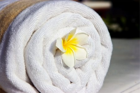 White hotel towel and yellow white tropical flower in it Stock Photo - Budget Royalty-Free & Subscription, Code: 400-04127684