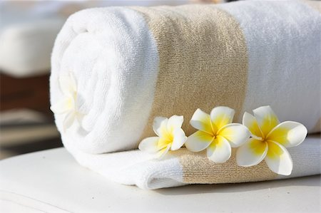 White hotel towel and yellow white tropical flowers Stock Photo - Budget Royalty-Free & Subscription, Code: 400-04127685