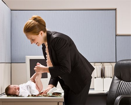 Businesswoman changing babyÕs diaper at desk Stock Photo - Budget Royalty-Free & Subscription, Code: 400-04129021