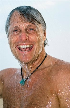 a colour portrait of a happy laughing forties man having a wash under a shower outdoors Stock Photo - Budget Royalty-Free & Subscription, Code: 400-04120891