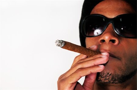 Portrait of young african american man smoking cigar - isolated Stock Photo - Budget Royalty-Free & Subscription, Code: 400-04120942