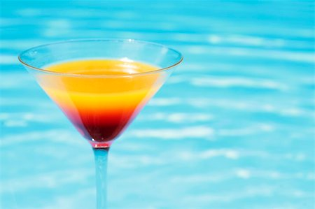 spanishalex (artist) - Colorful cocktail in front of attractive blue pool water Stock Photo - Budget Royalty-Free & Subscription, Code: 400-04122390