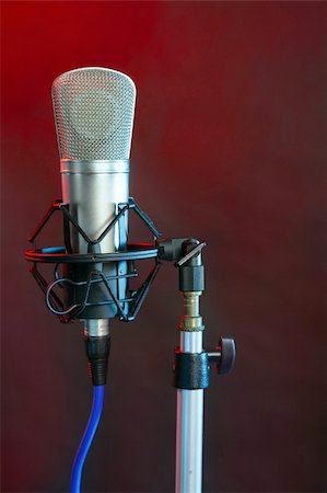 Microphone in the night colorful light in a recording studio Stock Photo - Budget Royalty-Free & Subscription, Code: 400-04136326