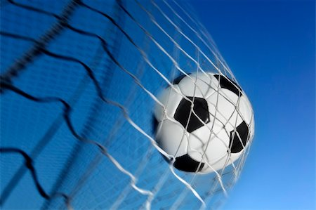 Soccer ball kicked into the back of a goal Stock Photo - Budget Royalty-Free & Subscription, Code: 400-04138651