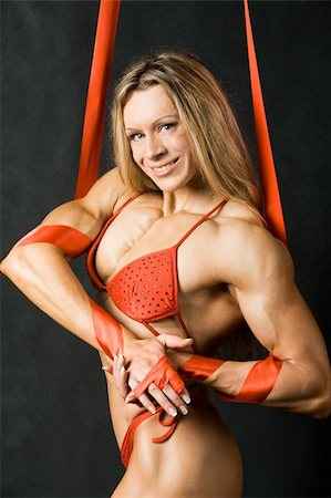 pressmaster - Portrait of strong female in red bikini smiling and looking at camera Stock Photo - Budget Royalty-Free & Subscription, Code: 400-04146026