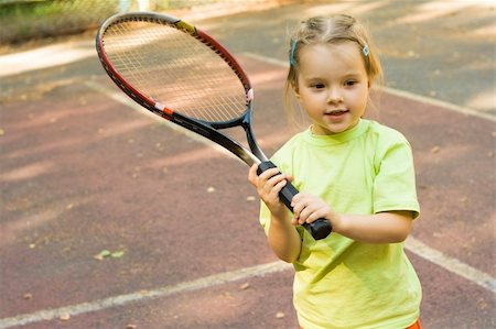 pressmaster - Nice girl with racket in hands playing game of tennis Stock Photo - Budget Royalty-Free & Subscription, Code: 400-04149128