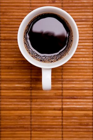 spanishalex (artist) - Cup of black coffee on a bamboo mat from above Stock Photo - Budget Royalty-Free & Subscription, Code: 400-04149358
