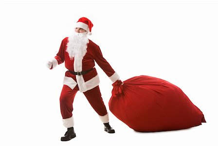 Portrait of happy Santa carrying heavy big red sack with presents Stock Photo - Budget Royalty-Free & Subscription, Code: 400-04142772