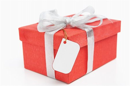 silver box - Red Christmas gift with blank tag, isolated over white Stock Photo - Budget Royalty-Free & Subscription, Code: 400-04158855