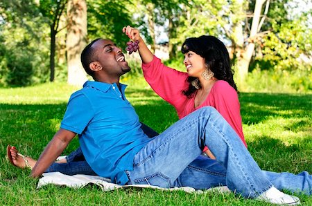 Young romantic couple having picnic in summer park Stock Photo - Budget Royalty-Free & Subscription, Code: 400-04151391