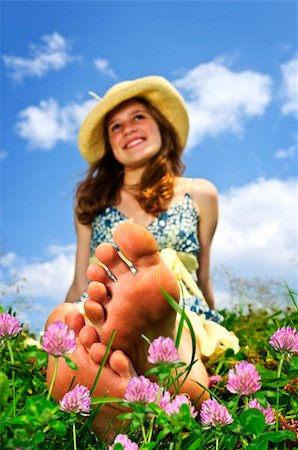 Young teenage girl sitting on summer meadow amid wildflowers in straw hat Stock Photo - Budget Royalty-Free & Subscription, Code: 400-04164104