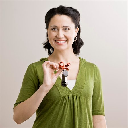 Portrait of mid adult woman with car keys tied with a bow. Square format. Stock Photo - Budget Royalty-Free & Subscription, Code: 400-04167639