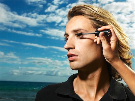 Young man with wind blown hair having mascara applied with the ocean in the background. Horizontal shot. Stock Photo - Budget Royalty-Free & Subscription, Code: 400-04169639