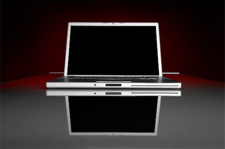 Image of a dark screen laptop on a glass table with reflection Stock Photo - Budget Royalty-Free & Subscription, Code: 400-04161467