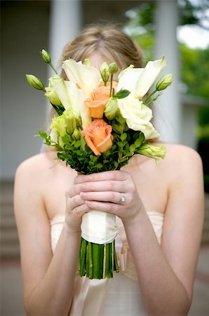 Image of a bride holding her bouquet over her face Stock Photo - Budget Royalty-Free & Subscription, Code: 400-04161888