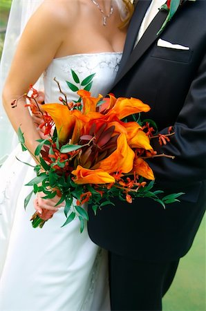 Image of a colorful bouquet being held by a bride and groom Stock Photo - Budget Royalty-Free & Subscription, Code: 400-04161969