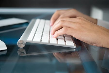 A woman hands typing on a computer keyboard Stock Photo - Budget Royalty-Free & Subscription, Code: 400-04161973
