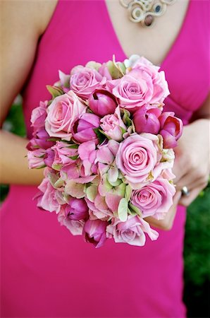 Image of a bridesmaid in a pink dress holding a pink bouquet Stock Photo - Budget Royalty-Free & Subscription, Code: 400-04162034
