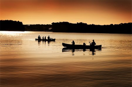 Image of silhouette of canoers on a lake Stock Photo - Budget Royalty-Free & Subscription, Code: 400-04162132