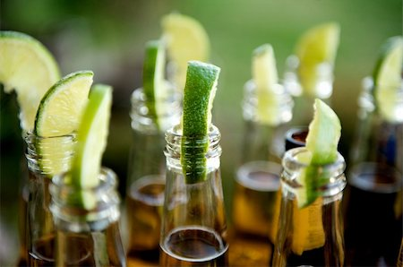 Close up image of multiple beer bottles with limes inserted Stock Photo - Budget Royalty-Free & Subscription, Code: 400-04162295