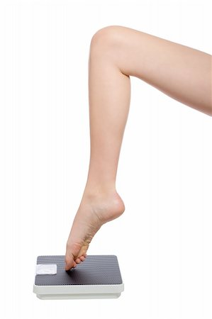 beautiful womans leg standing with the toe on a scale Stock Photo - Budget Royalty-Free & Subscription, Code: 400-04163768