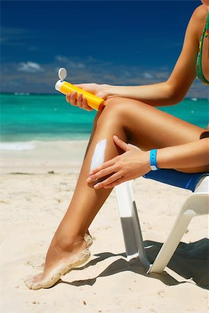 Tan woman applying sun protection lotion Stock Photo - Budget Royalty-Free & Subscription, Code: 400-04174280