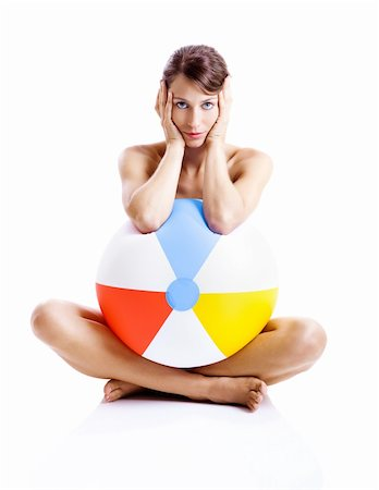 Beautiful young woman posing in bikini with a beach ball Stock Photo - Budget Royalty-Free & Subscription, Code: 400-04174820