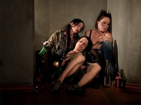 drunk passed out - Partygoers surrounded by booze bottles in a hallway Stock Photo - Budget Royalty-Free & Subscription, Code: 400-04175158