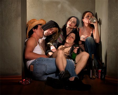 drunk passed out - Partygoers surrounded by booze bottles in a hallway Stock Photo - Budget Royalty-Free & Subscription, Code: 400-04175159