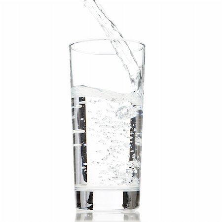 Water been poured into a glass on a white background Stock Photo - Budget Royalty-Free & Subscription, Code: 400-04175342