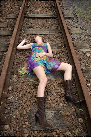 dead female body - Girl lies dead on the railway tracks Stock Photo - Budget Royalty-Free & Subscription, Code: 400-04175963