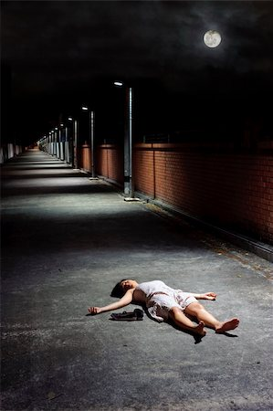 dead female body - Female lies dead in the street under a night sky Stock Photo - Budget Royalty-Free & Subscription, Code: 400-04177329
