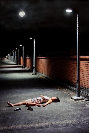 dead female body - Woman lies vulnerable in the vacant street Stock Photo - Budget Royalty-Free & Subscription, Code: 400-04177330