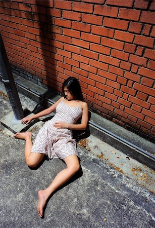 dead female body - Asian girl is passed out in the gutter Stock Photo - Budget Royalty-Free & Subscription, Code: 400-04178269