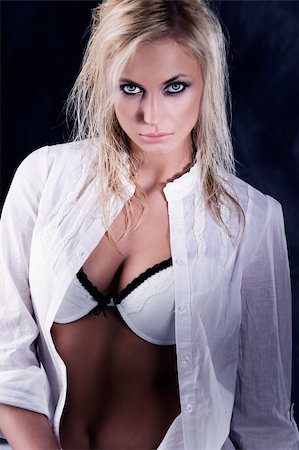 cute ans sexy blond girl in a fashion shot wearing an open white shirt showing bra. strong contrast Stock Photo - Budget Royalty-Free & Subscription, Code: 400-04179303